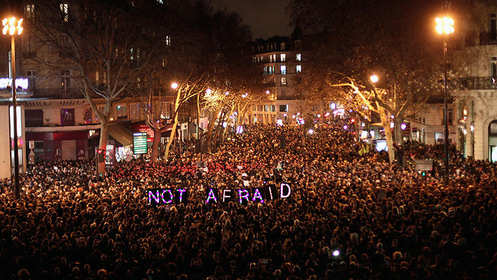 "People gather to pay respect for the victims of a terror attack against a satirical newspaper, in Paris, Wednesday, Jan. 7, 2015. Masked gunmen shouting ""Allahu akbar!"" stormed the Paris offices of a satirical newspaper Wednesday, killing 12 people, including the paper's editor, before escaping in a getaway car. It was France's deadliest terror attack in living memory. (AP Photo/Thibault Camus)"