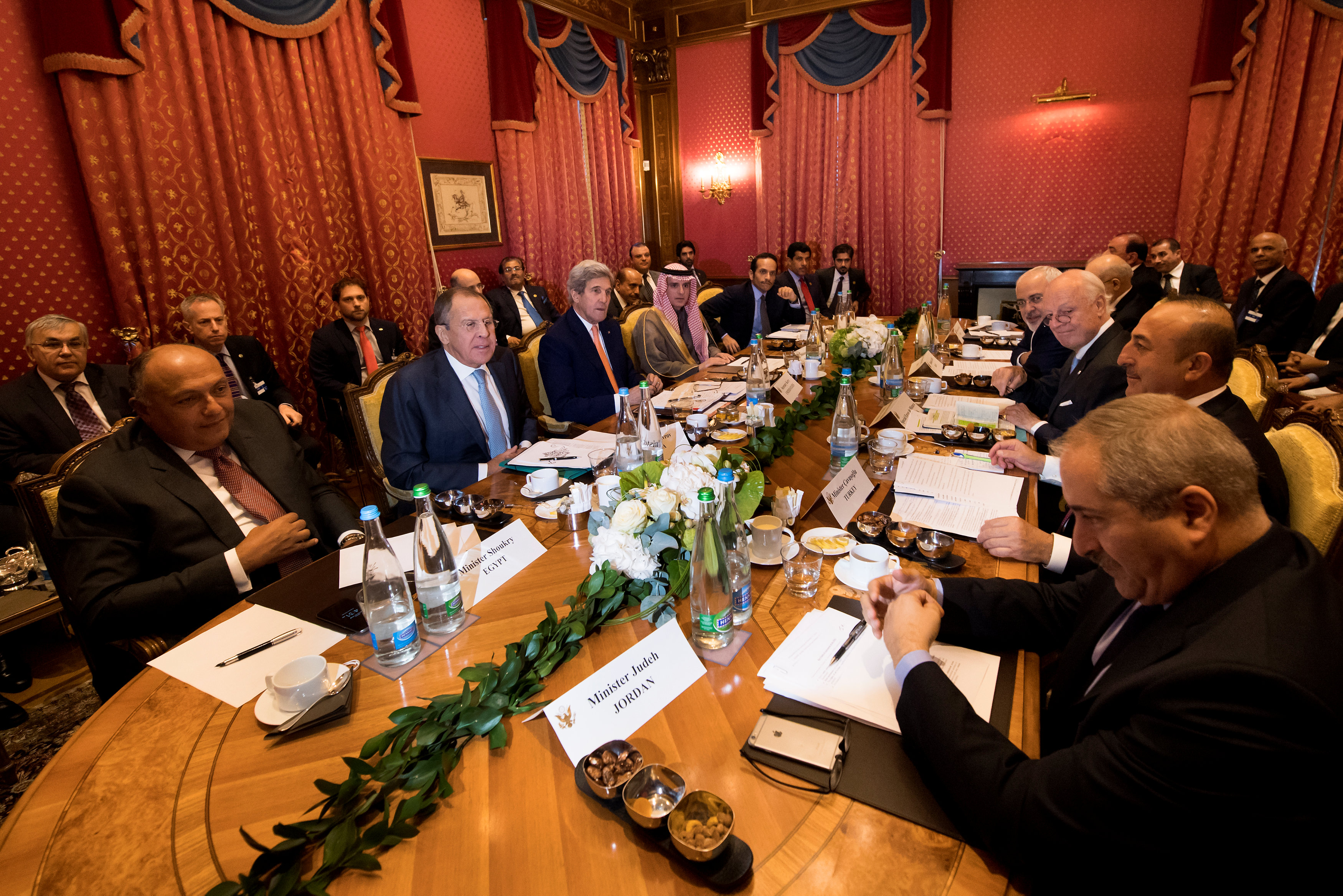 Foreign ministers meet around a table during a bilateral meeting where they discussed the crisis in Syria, in Lausanne
